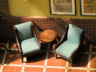 Chairs in a sunlit lobby