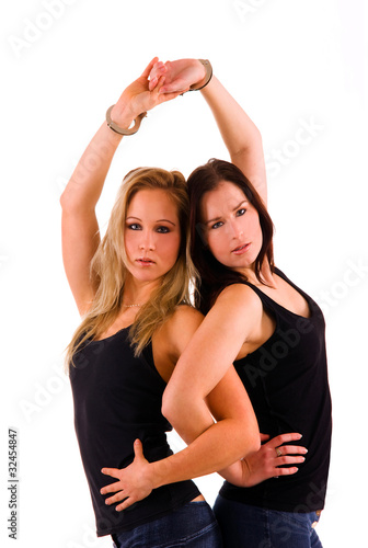 sexy women handcuffed to each other