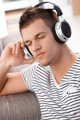 Young man listening music eyes closed