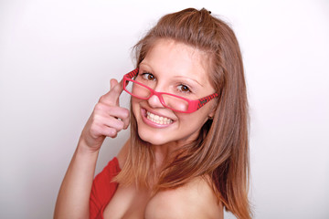 Close-up portrait of a beautiful young woman touching glasses