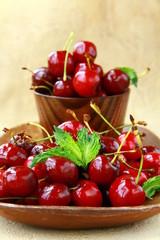 fresh organic ripe black cherry with mint leaf