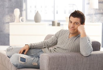 Portrait of happy man on couch