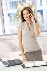 Cheerful businesswoman on phone