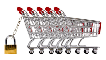 Row of shopping trolleys secured and isolated on white