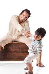 Father and little son studio portrait