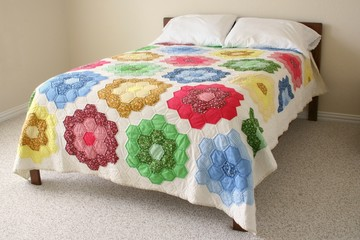 Bed with colorful floral quilt
