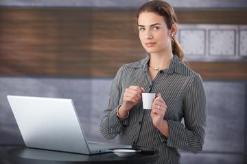 Pretty businesswoman having a break