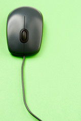 Computer mouse isolated on the green background
