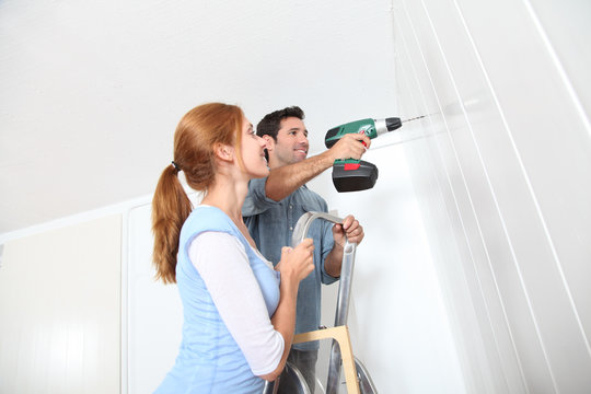 Young couple renovating their new house