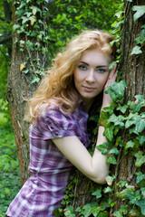 Woman near tree with climber plant
