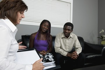 A Businesswoman Meeting With A Couple