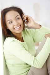 Portrait of happy woman on call