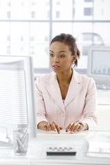 Ethnic businesswoman working at desk