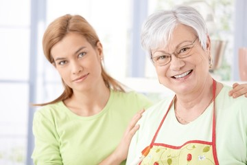 Portrait of senior mother and daughter smiling