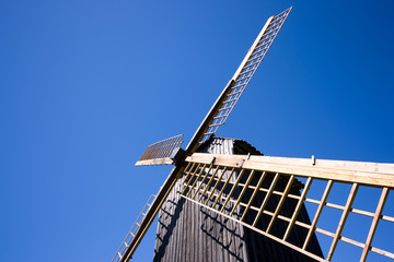 Windmill over blue sky, copyspace for your text