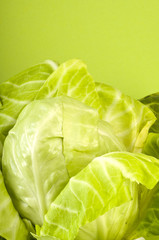 Fresh cabbage on green