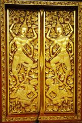 gold paint on church door