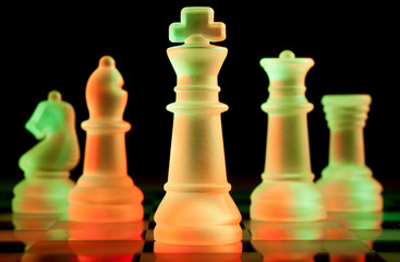 red and green glass chess pieces