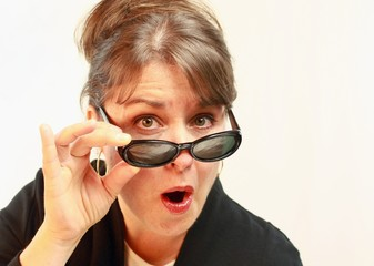 Woman with sunglasses on tip of nose.