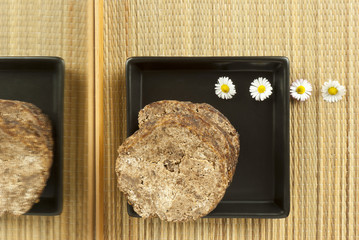 african handmade black soap with white flowers
