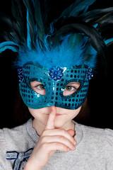 Beautiful litlle girl wearing blue mask