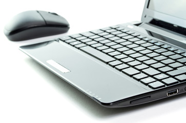 Black netbook with mouse isolated on white