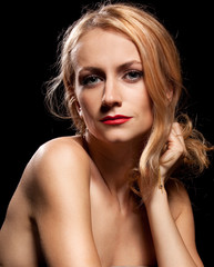 Fashion portrait of sensual young woman on black background