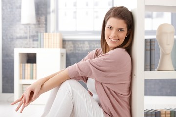Happy woman in smart living room