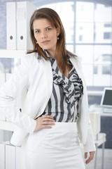 Trendy businesswoman in office