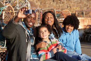 Happy family taking photo