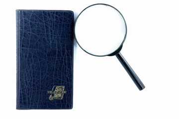 magnifying glass and books