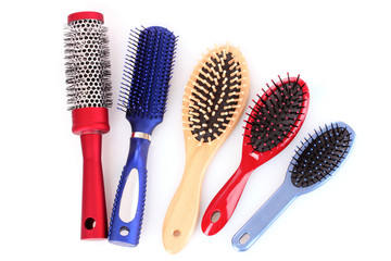 Different types of hairbrushes isolated on white