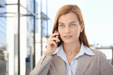 Beautiful businesswoman talking on mobile phone