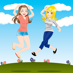 Happy girls jumping on grass field