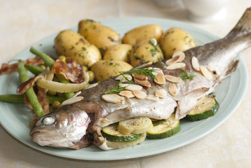 Oven-baked trout with fennel and courgettes
