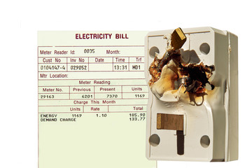Electricity bill and burned electrical adapter, plug. Concept