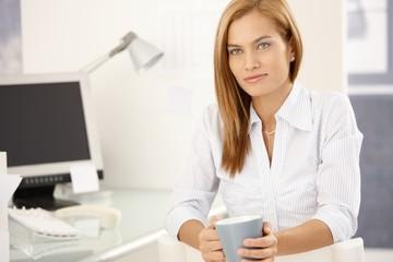 Office girl enjoying coffee break