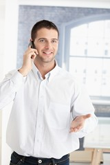 Happy young man on phone