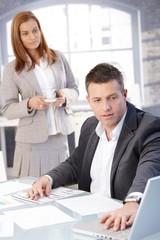 Handsome businessman working at desk