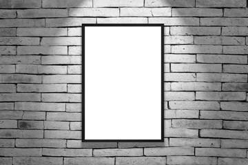 One black frame on gray brick wall
