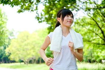 beautiful asian woman jogging in the park