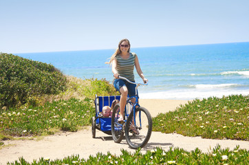 Family enjoying a beachside Bicycle Ride