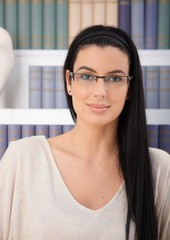 Portrait of smiling woman in glasses