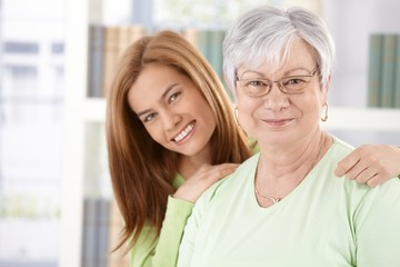Portrait of elderly mother and daughter smiling