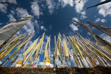 Buddhist flags and deep blue sky