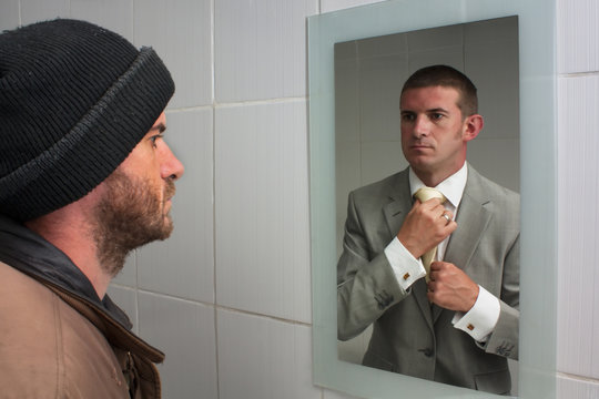 Unemployed man looking in mirror and seeing the future