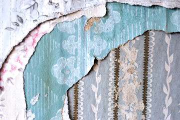 Layers of torn wallpaper