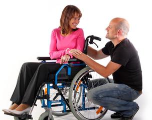 Rollstuhl paar reden Hand