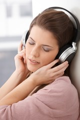 Woman daydreaming with headphone