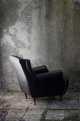 black armchair and grey wall